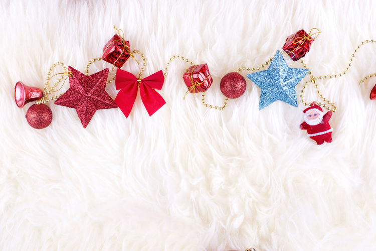 Close-up of christmas decorations on rug