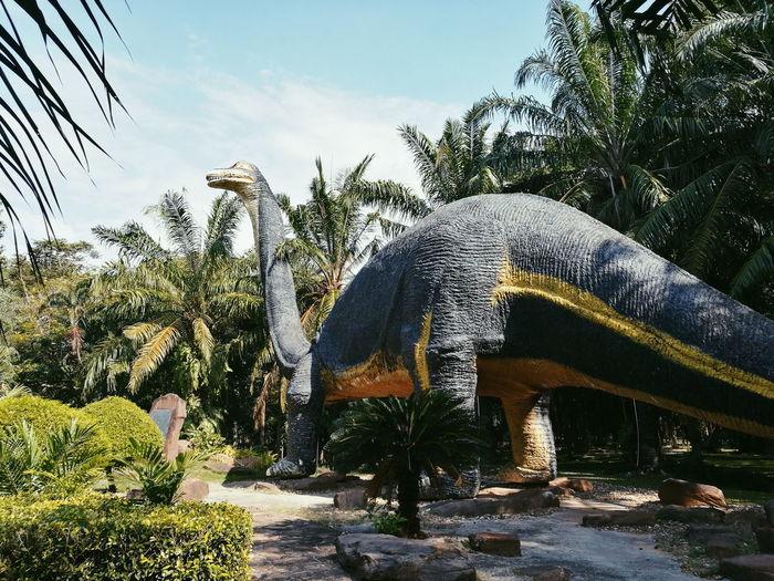 animals Dinosaur No People Outdoors Day Sky Tree Sky
