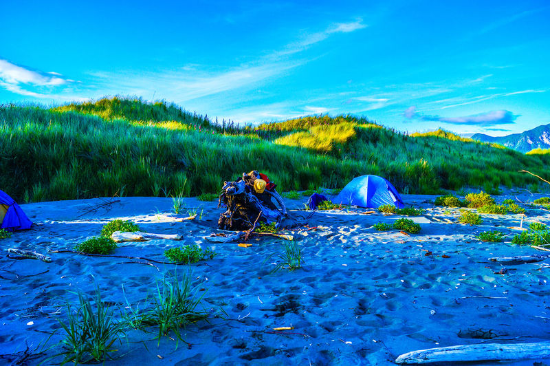 Beach Beauty In Nature Blue Camping Day Leisure Activity Lifestyles Nature Relaxation Scenics Sitting Sky Sunlight Sunset Tents Tranquil Scene Tranquility Blue Wave • The Great Outdoors – 2016 EyeEm Awards