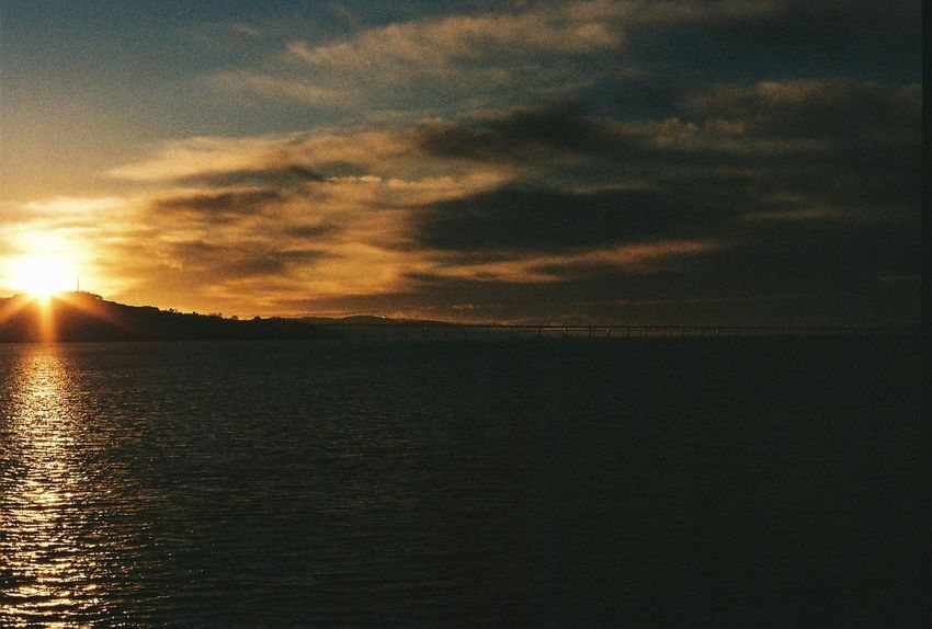 Sunset over the Tay River Film Filmphotography Pentax Pentaxp30n 200iso Gramthedee Dundee Bonniedundee VisitScotland Scotland BonnieScotland Thephotograbber Sunset Nature Beauty In Nature Scenics Water Sky Reflection No People Cloud - Sky Tranquility Outdoors Silhouette Sea Day