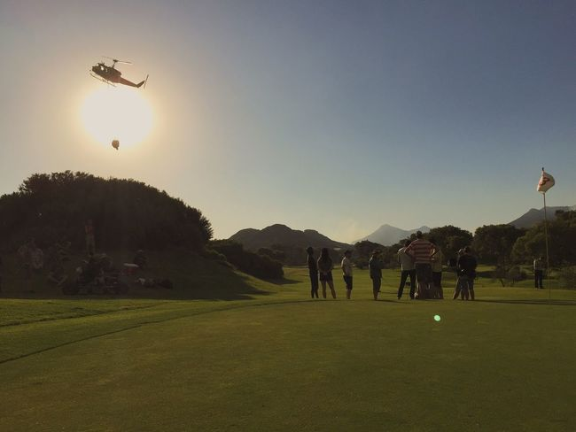 Firefighter Golfing Golf Helicopter Sundown Capetown Clovelly  Perfect Match WORKHARD Hello World Perfect Moment Africa On The Golf Course! Nature Outdoors Sport Produceratwork Workhardplayhard Producer Filmset Professional Setlife Shooting Silhouette Work