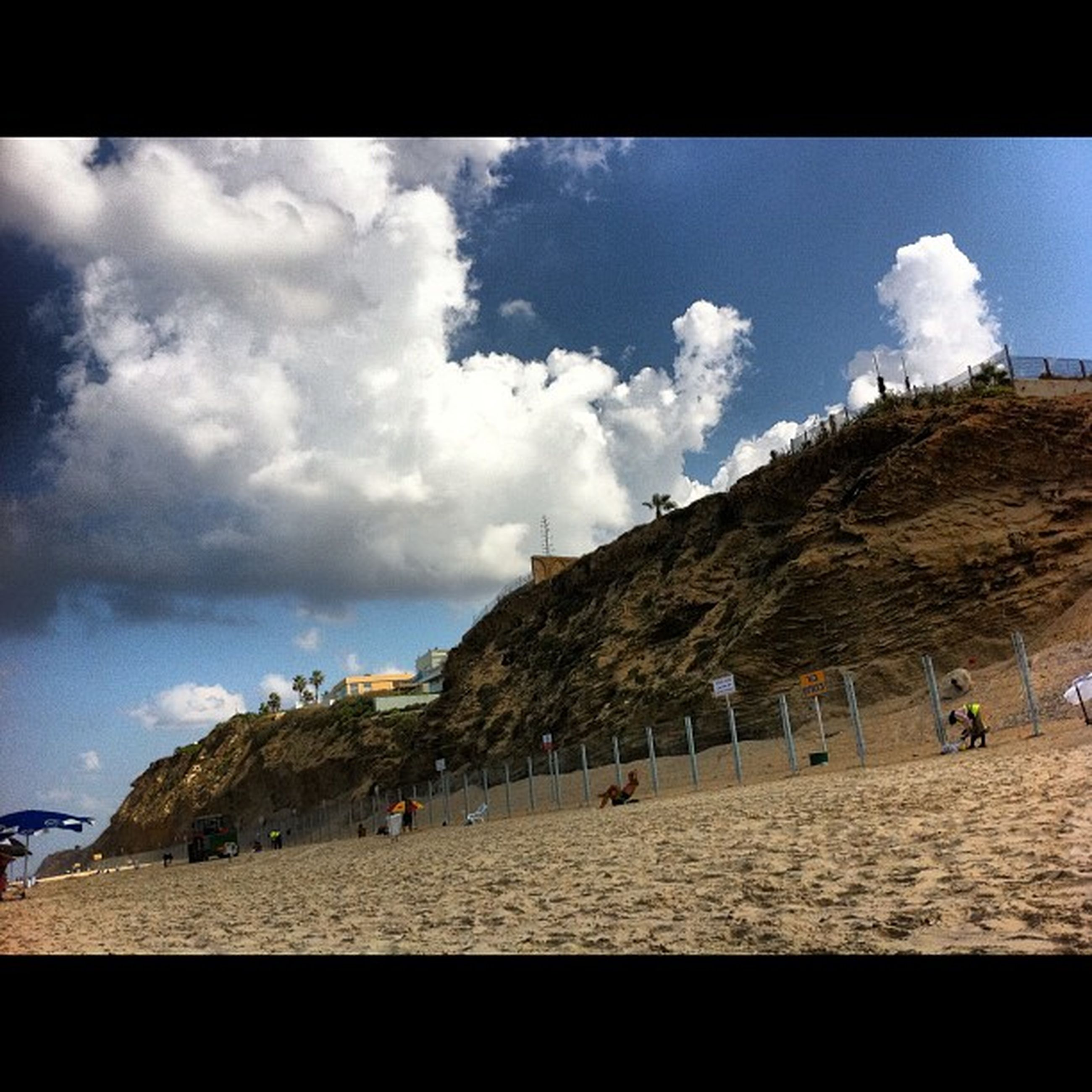 transfer print, sky, auto post production filter, cloud - sky, cloud, cloudy, large group of people, built structure, beach, lifestyles, mountain, tourist, panoramic, men, person, nature, sea, leisure activity, architecture