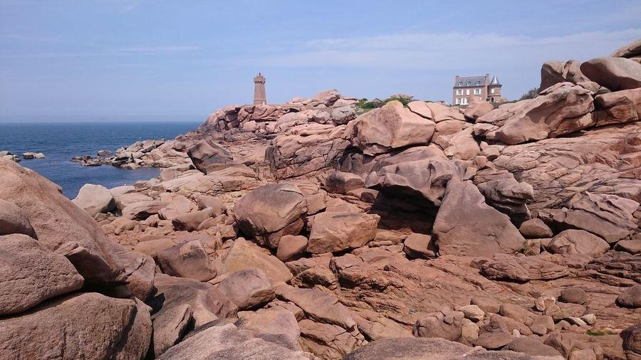 Rocky Shore Against Sky