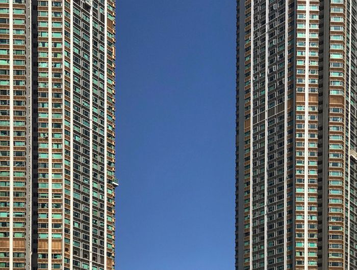 Architecture Skyscraper Built Structure Building Exterior Tall - High Low Angle View Modern City Blue Window Clear Sky Apartment No People Sky Lifestyles Hong Kong Outdoors The Mobile Photographer - 2019 EyeEm Awards The Architect - 2019 EyeEm Awards