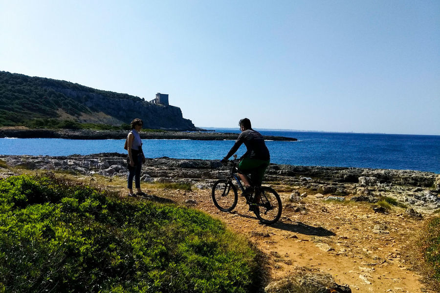 Bicycle Water Cycling Sky Transportation Sea Day Nature Outdoors Men People Togetherness Headwear Adult Clear Sky Real People Mountain Bike Beauty In Nature Adults Only Porto Selvaggio Salento Porto Selvaggio Nardo Lecce Italy