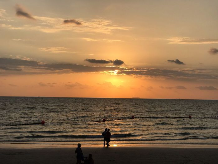Sky Beach Sunset Sea Water Land Beauty In Nature Cloud - Sky Orange Color Scenics - Nature Real People Horizon Over Water Horizon Nature Men Two People Silhouette Lifestyles Togetherness Outdoors