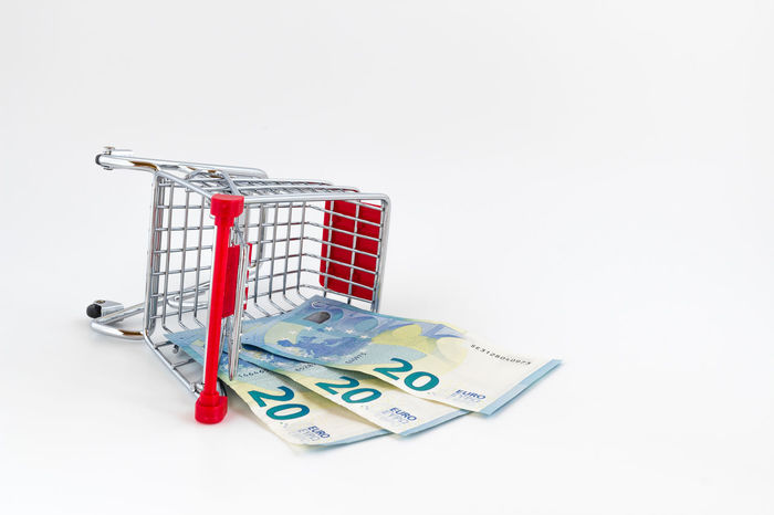 Small shopping cart with euros banknotes. Conceptual representation of wrong choice, error but also economic weight. Accident Banknotes Bankrupt Broke Business Cart Consumer Consumerism Crash Crisis Discount Down Economy Empty Euros Failure  Financial Playing Poor  Poverty Retail  Sale Shopping Supermarket
