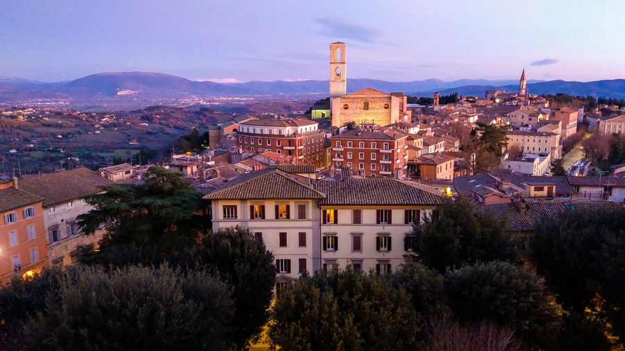 Romantic view of Perugia at sunset in Umbria Perugia Umbria City Town Architecture Dusk Twilight Travel Destinations Buildings Landmark Church Italy Travel Wanderlust Europe Romantic Sky Landscape Sunset_collection Sunset Winter Card Background Building Exterior Built Structure Building Tree Residential District Plant Nature Sky No People Mountain High Angle View Outdoors Cityscape Day Roof House Cloud - Sky TOWNSCAPE