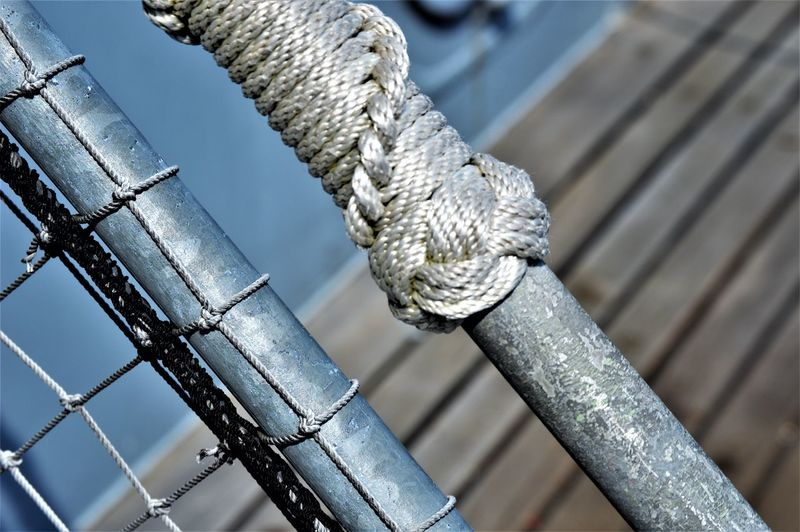 Ropes, Knots, Ladder, Battleship... Ladder Railing Rope US Navy Battleship Close-up Day Focus On Foreground High Angle View Knot Metal Nautical Nautical Rope Navy No People Pattern Protection Rope Rope Knot Selective Focus Ship Silver Colored Strength Tied Knot Wood - Material 17.62°