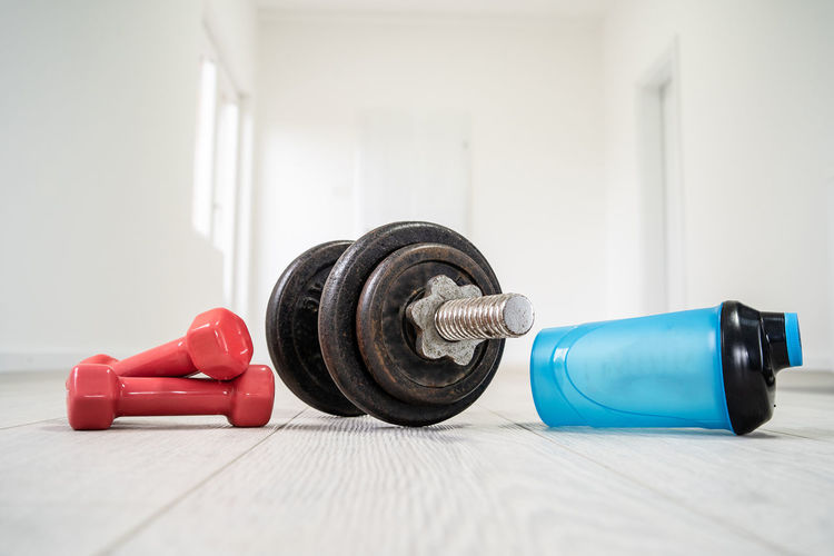 Weights Indoors  Dumbbell Sports Training Weight Exercise Equipment Weight Training  Still Life Exercising Healthy Lifestyle Sports Equipment Muscular Build Strength Sport Lifestyles Gym Focus On Foreground Heavy Close-up