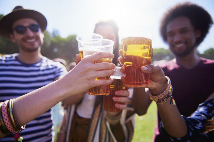 Beer Toast Friends Festival Music Festival Drink Hand Celebratory Toast Traditional Festival Alcohol People Part Of Summer Outdoors Party Music Celebrate Group Of People Togetherness Bond Entertainment Adult Young Adult Carefree Freedom Cheer Meeting Vacations Youth Culture Traveling Carnival Popular Music Concert Live Event Close Up Sunlight Sunny Human Body Part