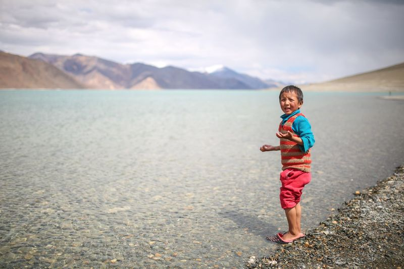 Local folks Childhood Child Full Length Water One Person Real People Mountain Lifestyles Innocence Lake Casual Clothing Standing Day Nature Outdoors
