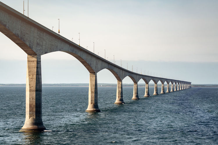 Premium Collection The EyeEm Collection Connection Bridge Water Bridge - Man Made Structure Sea Sky Built Structure Architecture Architectural Column Horizon Waterfront Engineering Transportation Horizon Over Water Nature Clear Sky Day Outdoors Prince Edward Island Canada River St Lawrence River Morning Architecture Transportation Tranquility No People Nature