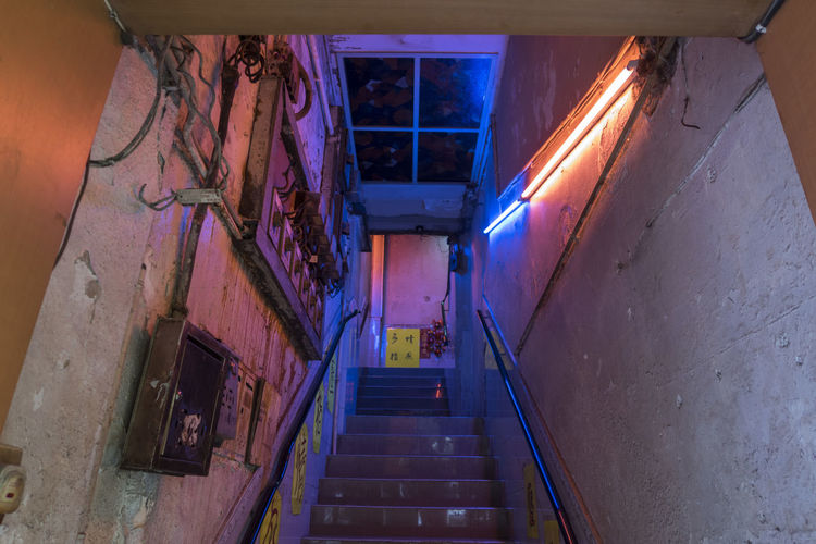 Abandoned Alley Architecture Building Built Structure Ceiling Diminishing Perspective Direction Empty Illuminated Indoors  Lighting Equipment Low Angle View Night No People Railing Staircase Steps And Staircases The Way Forward Wall - Building Feature