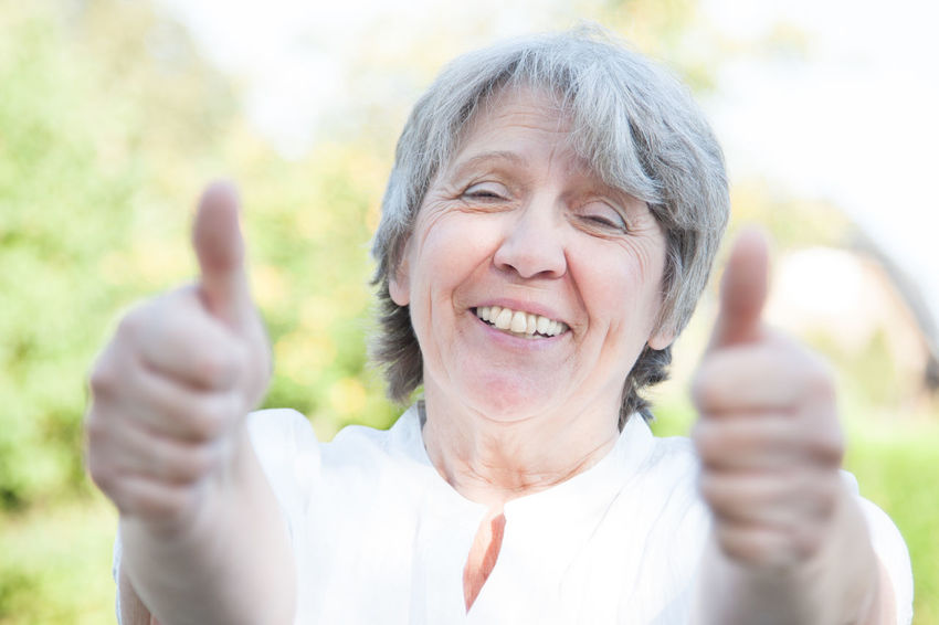 Old age woman showing thumbs up with both hands Compliment Gesture Good Mood Grandmother Granny Hand Sign Happiness Happy Woman Old Age People Old Woman Outside Portrait Portrait Of A Woman Positive Energy  Recommendation Retirement Retirement Home Senior Senior Adult Senior Portrait Thumbs Up