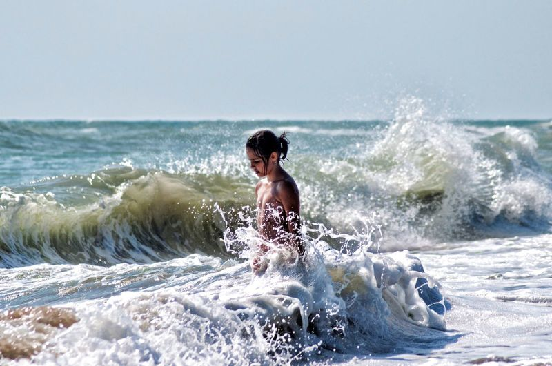 Splashing Sea Motion Wave One Person Outdoors Beach Vacations Water Fun Healthy Lifestyle The Week On EyeEm Mix Yourself A Good Time Perspectives On Nature