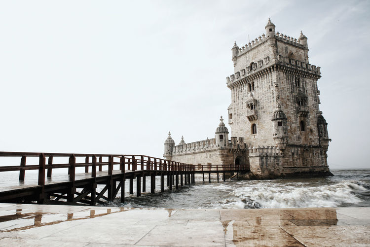 belem tower Belém Castle Architecture Belem Tower Building Exterior Built Structure Day History Nature No People Outdoors Sky Tourism Travel Destinations Water Stories From The City Go Higher