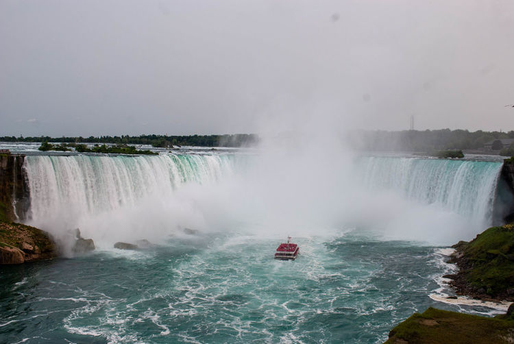 Water Scenics - Nature Motion Waterfall Beauty In Nature Travel Destinations Tourism Waterfront Power Nature Nautical Vessel Travel Day Power In Nature Splashing Sea Surfing Flowing Water Outdoors Passenger Craft Flowing Niagara Falls