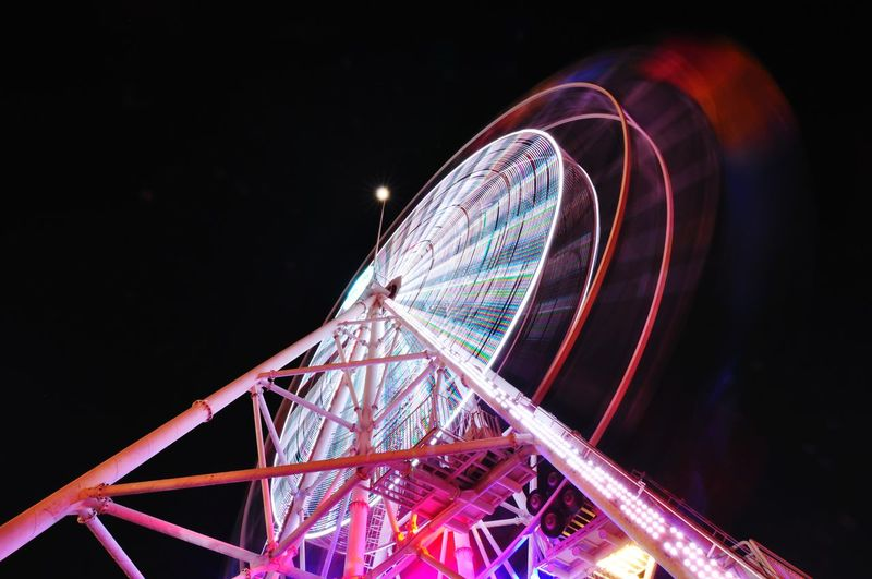 EyeEm Selects Night Ferris Wheel Amusement Park Arts Culture And Entertainment Amusement Park Ride Low Angle View Long Exposure Sky Outdoors Lights