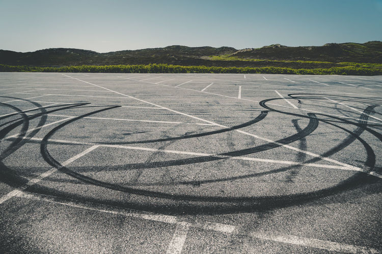 Rubber Tracks Beauty In Nature Clear Sky Day Environment Land Landscape Nature No People Non-urban Scene Outdoors Parking Pattern Rubber Scenics - Nature Shadow Sky Sunlight Tire Track Tranquil Scene Tranquility