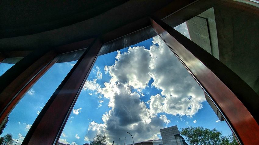 Low Angle View Sky Cloud - Sky Window Day Architecture Built Structure Outdoors No People Building Exterior Tree City Low Angle Shot Low Angle Of View Low Angle Perspective
