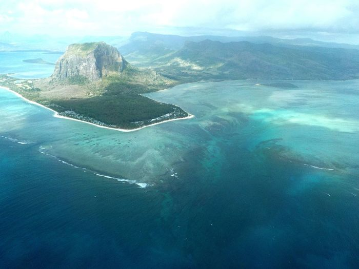 Underwater waterfall of Mauritius. Dazzling illusion. Cascade sous-marine de l'île Maurice. Éblouissante illusion. Beauty In Nature UnderSea Nature Outdoors Sea Water Tourism Day Swimming Mountain Sky No People First Eyeem Photo Underwaterwaterfall Mauritius Mauritiusisland Illusion Clouds Fiftyshadesofnature FiftyShadesOfBlue EyeEmNewHere Miles Away