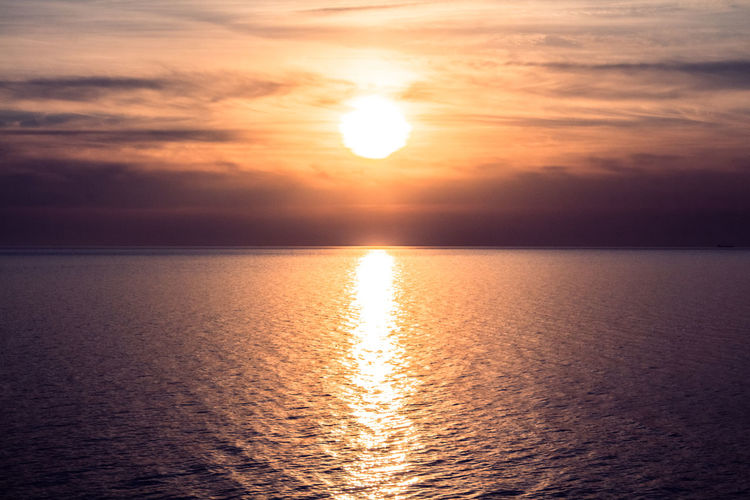 Beauty In Nature Cloud - Sky Colorful Colors Horizon Over Water Nature Rippled Sea Sky Sun Sunlight Sunset Water Waterfront