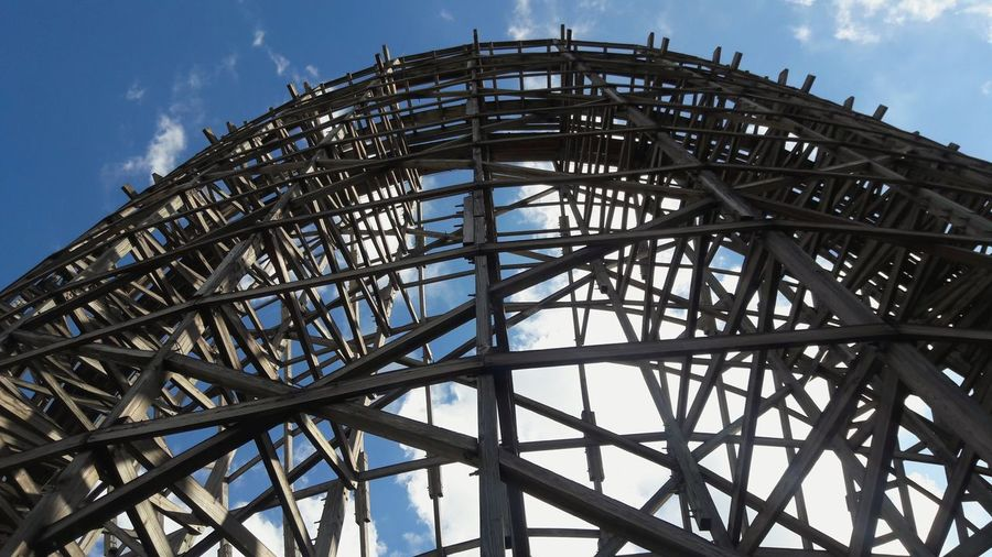 Arts Culture And Entertainment Sky Rollercoaster Cloud - Sky Business Finance And Industry Amusement Park Vacations Outdoors Day Wooden Structure Wooden Roller Coaster