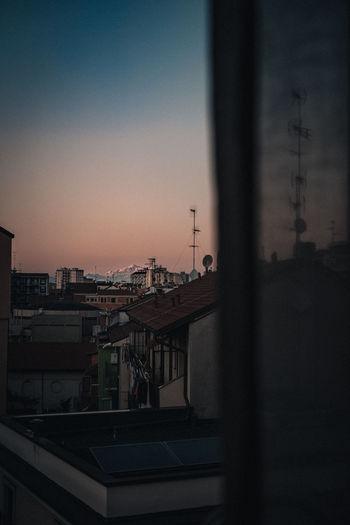 Buildings against clear sky at dusk