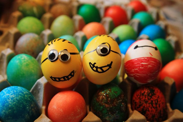 Colorful easter eggs in egg crate