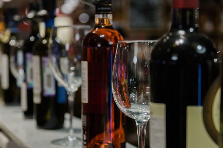 different wine and tasting glasses Bottle Refreshment Alcohol Drink Food And Drink Container Wine Glass - Material Glass Transparent Wine Bottle Indoors  Focus On Foreground Wineglass Close-up No People Still Life Table Red Wine Bar - Drink Establishment Bar Counter