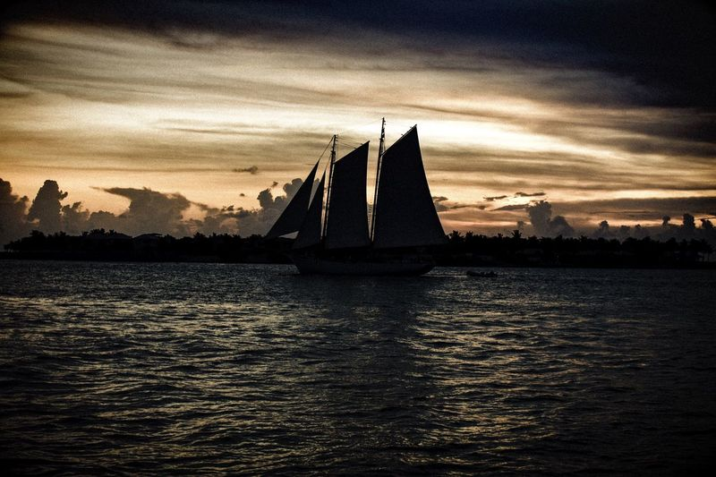 A6000 Oceanside Key West Sailboat Enjoying Life Moody Darkness And Light Single Ship Alone On The Water Nice View not your standard Sunset