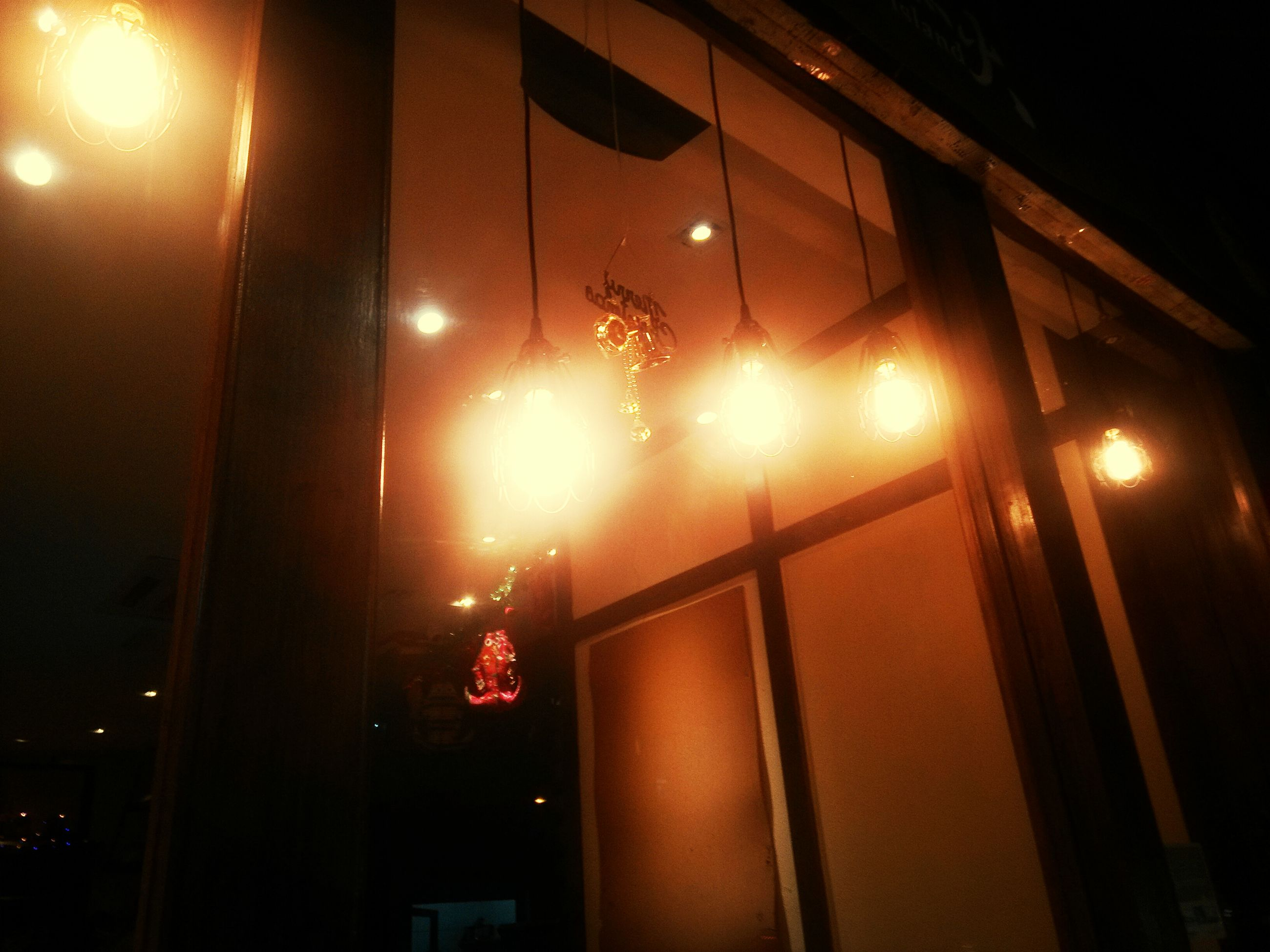 illuminated, night, lighting equipment, indoors, light - natural phenomenon, glowing, window, built structure, architecture, red, lens flare, electric light, glass - material, low angle view, street light, no people, dark, electricity, light beam, lit