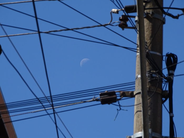 ezefer Moon Cable Cables Connection Day Electrical Electrical Equipment Electricity  Electricity  Electricity Pylon Low Angle View Nature No People Outdoors Power Line  Power Supply Sky Technology