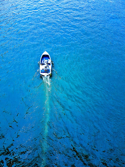 High angle view of man swimming on tje boat in sea