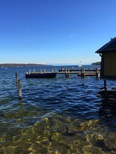 Water Clear Sky Blue Sea No People Sky Boot Bootsteich Steg Anlegestelle BootshausAmSee Berge Klares Wasser Frühling