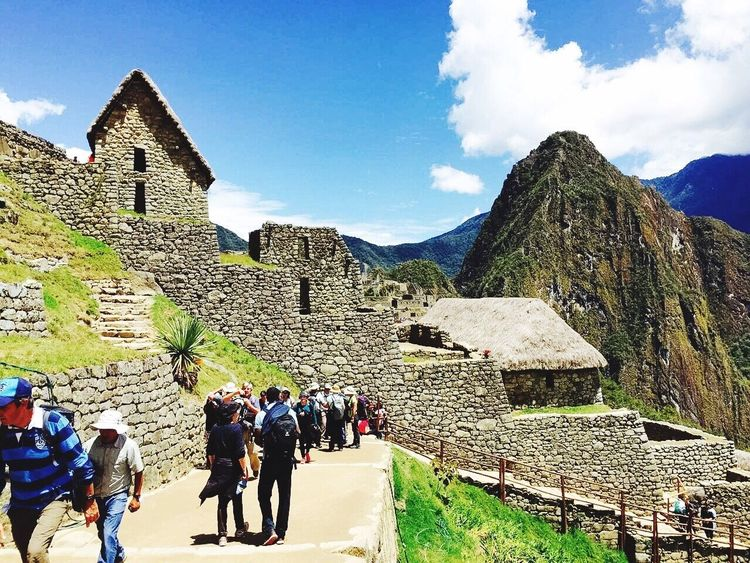 In a wonderful day, take a wonderful stroll, at the wonderful Wonder of the World-Machu Pichuu Wonder Of The World Machu Picchu Cusco Peru Ancient House Ancient Ruins Mountains Ancient Roads Travel Group Of People People Together People Together By August 3 2016 Athleisure Colour Of Life A Bird's Eye View Eyeemphoto Two Is Better Than One Two Windows On Each Building People And Places