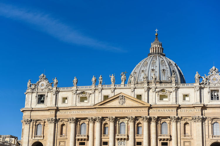 High section of st peter basilica church against blue sky