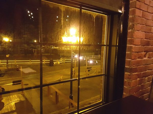 Second Acts So warm and inviting. Window Night Illuminated Indoors  No People Built Structure Architecture Sky Oceans Business Finance And Industry My Point Of View. Saint John Canada, Eh? Outdoors Water Phoyooftenday Windiws Window View Window Frame Brick Wall Bridge - Man Made Structure Red Color Nightscape Frame It!