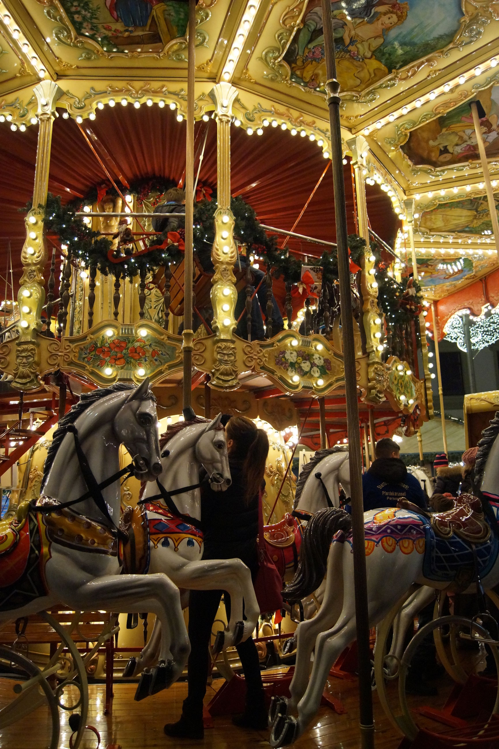 indoors, illuminated, arts culture and entertainment, travel, religion, carousel, place of worship, amusement park, lighting equipment, incidental people, spirituality, decoration, amusement park ride, travel destinations, hanging, ornate, cultures, built structure, low angle view