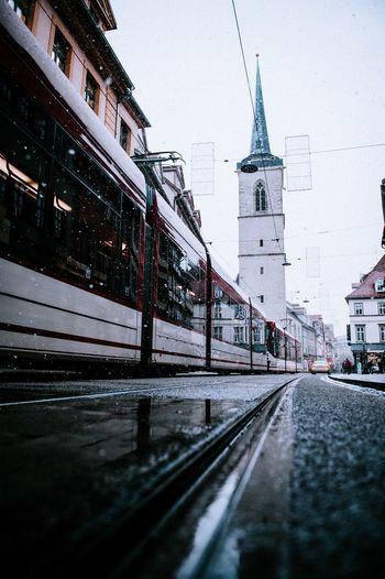 Tram / Straßenbahn / Snow Tram Erfurt Straßenbahn Built Structure Architecture Building Exterior Transportation City Snow Cold Temperature Road Street Nature Mode Of Transportation Car Sky Building Winter The Way Forward No People Motor Vehicle Tower Spire