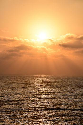 Apocalyptic Sky Sunset Sea Water Scenics - Nature Cloud - Sky Sunlight Horizon Horizon Over Water Beauty In Nature Tranquility Nature Tranquil Scene Idyllic Seascape Dramatic Sky Sun No People Sunbeam Bright Sunrays Sunlight Warm Colors Outdoors