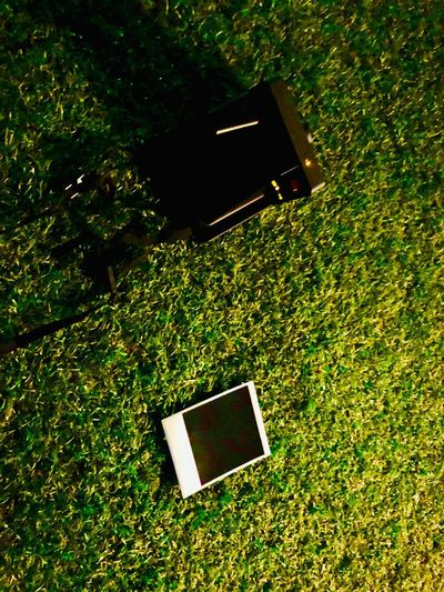 High angle view of camera phone on field