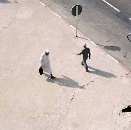 High angle view of men standing in city