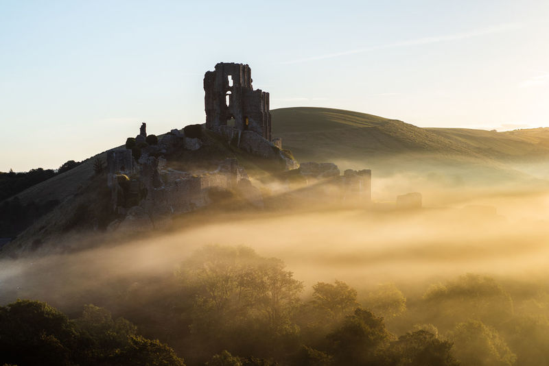 corfe castle in the early morning mist at sunrise Copy Space Dorset EyeEm Best Shots Tourist Attraction  Ancient Civilization Architecture Beauty In Nature Built Structure Corfe Castle Day Environment Fog History Land Mist Misty Morning Mountain Nature No People Non-urban Scene Outdoors Places To Visit Places You Must To See Plant Ruined Scenics - Nature Sky Sunrise The Past Tourist Destination Tranquil Scene Tranquility Travel Destinations Tree