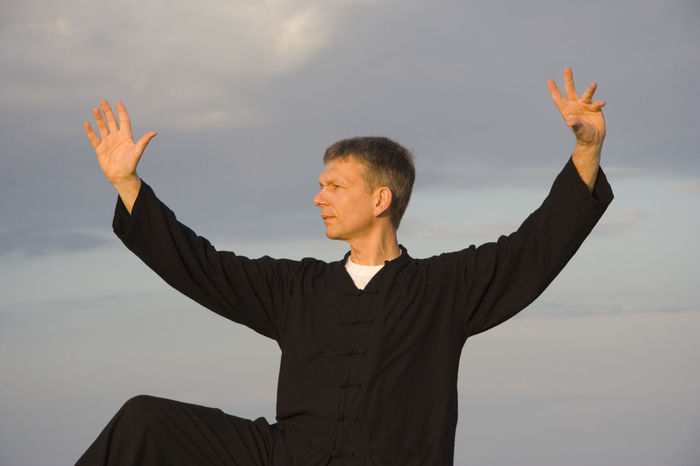 tai chi - posture kick with right heel - art of self-defense Arms Raised Close-up Exercise Fitness Fitness Training Healthy Healthy Lifestyle Human Hand Martial Arts Meditation Men One Man Only One Person Outdoors Qi Gong Sky Sport Sports Clothing Tai Chi Tai Chi Chuan Taiji Taijiquan Training Waist Up Zen