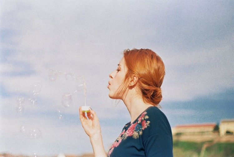 Spring Springtime Florals Ginger Analogue Photography 35mm Film Photography Zenit Redhead Blowing Bubbles Bubbles Soap Bubbles Having Fun Enjoying Life Sunny Day The Week On Eyem Showcase July Enjoy The New Normal