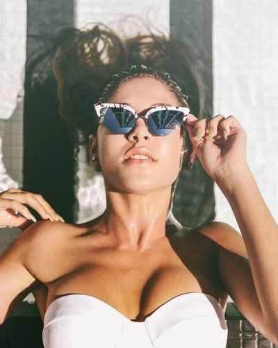 Summer of Sami Fashion Stories Pool Time Summertime Sunglasses Reflection Beautiful Woman Beauty Building Exterior Close-up Day Front View Headshot Leisure Activity Lifestyles One Person Outdoors Poolside Real People Retro Style Retro Styled Summer Vibes Sunglasses Warm Weather Women Young Adult Young Women