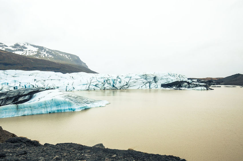 Days of travel: 7 - Svinafellsjokull glacier Iceland Beauty In Nature Cold Temperature Day Environment Glacier Glaciers Ice Iceberg Lake Landscape Melting Mountain Mountain Peak Nature No People Reflection Scenics - Nature Sky Snow Snowcapped Mountain Tranquil Scene Tranquility Water Winter The Great Outdoors - 2018 EyeEm Awards