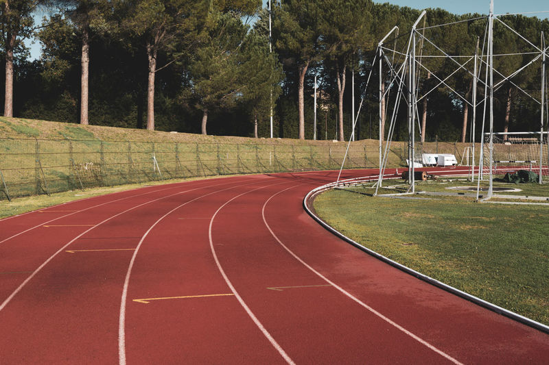 stadium running track Sport Plant Tree Track And Field Grass Absence Running Track Sports Track No People Nature Day Empty Curve Outdoors Red Direction Competition Athleticism Run Athletics Stadium Urban City Lines